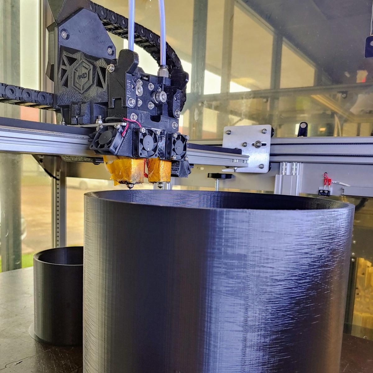 3d printer printing two couplings