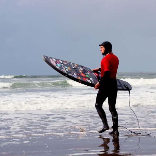 1st of 4 surfers heads out. Photo by Katy